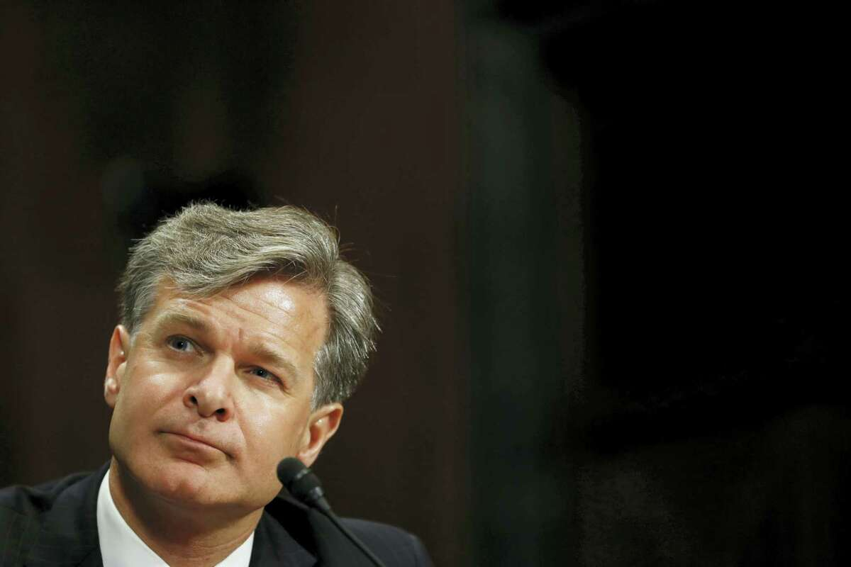 FBI Director nominee Christopher Wray listen as he testifies on Capitol Hill in Washington, Wednesday, July 12, 2017, at his confirmation hearing before the Senate Judiciary Committee.