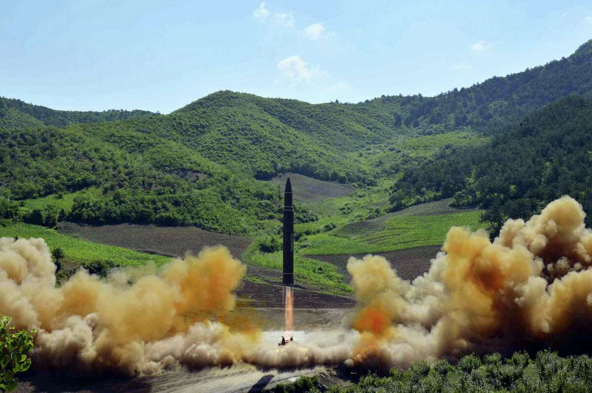 This July 4, 2017, file photo, distributed by the North Korean government shows what was said to be the launch of a Hwasong-14 intercontinental ballistic missile (ICBM) in North Korea's northwest. Kim Jong Un has something his father and grandfather could only dream of, an intercontinental ballistic missile capable of striking the United States with a nuclear weapon. Independent journalists were not given access to cover the event depicted in this photo.