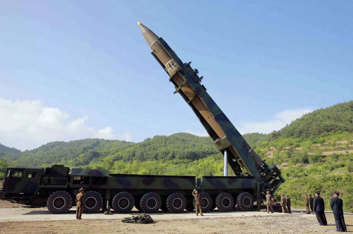 In this July 4, 2017, file photo distributed by the North Korean government, North Korean leader Kim Jong Un, second from right, inspects the preparation of the launch of a Hwasong-14 intercontinental ballistic missile (ICBM) in North Korea's northwest. Kim Jong Un has something his father and grandfather could only dream of, an intercontinental ballistic missile capable of striking the United States with a nuclear weapon. Independent journalists were not given access to cover the event depicted in this photo.