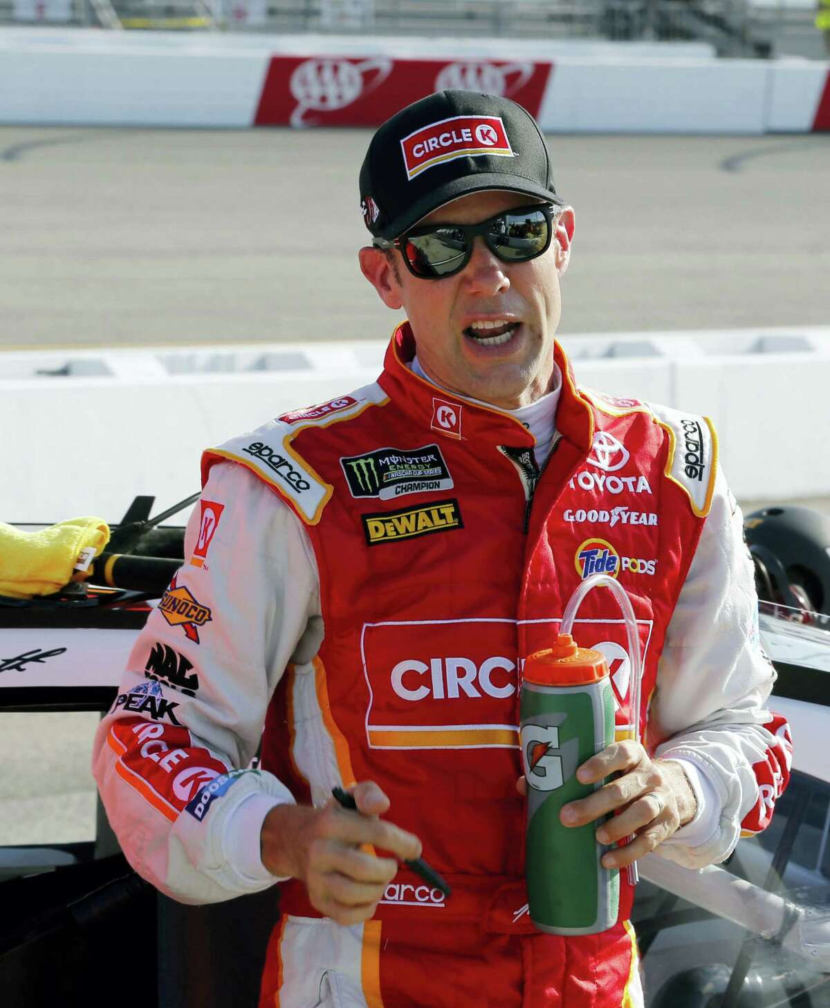In this file photo, Matt Kenseth talks to one of his crew during qualifying for the NASCAR Cup Series auto race at Richmond International Raceway, in Richmond, Va. Kenseth said Friday he has no job lined up next year and likely has no future at Joe Gibbs Racing.