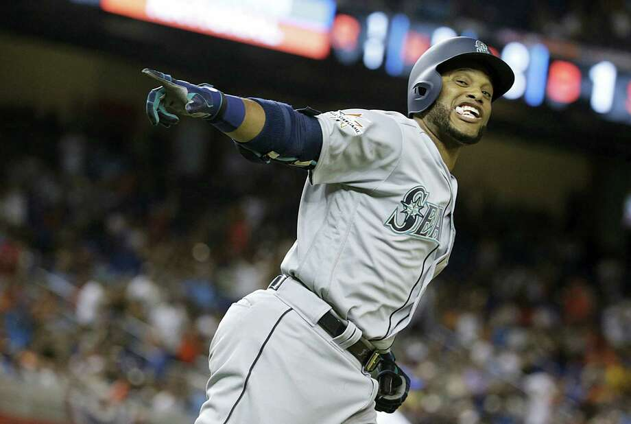 The American League's Robinson Cano rounds the bases after hitting a home run in the 10th inning Tuesday. Photo: Lynne Sladky — The Associated Press  / Copyright 2017 The Associated Press. All rights reserved.