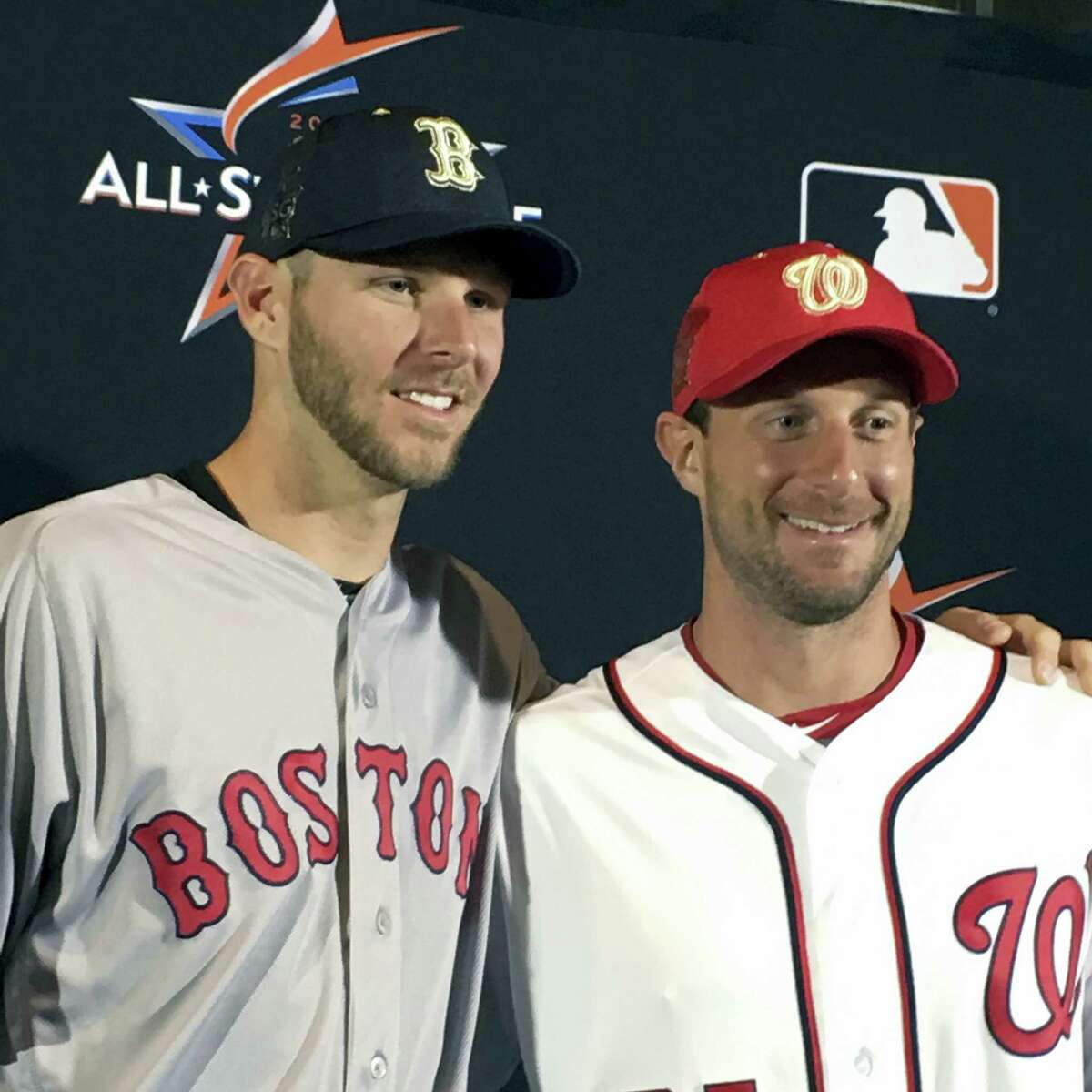 American League pitcher Chris Sale, left, poses with National League pitcher Max Scherzer at a press conference in Miami on Monday.