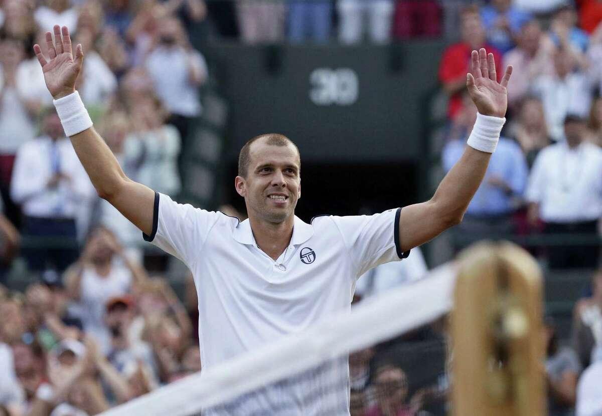 Gilles Muller celebrates after beating Rafael Nadal on Monday.