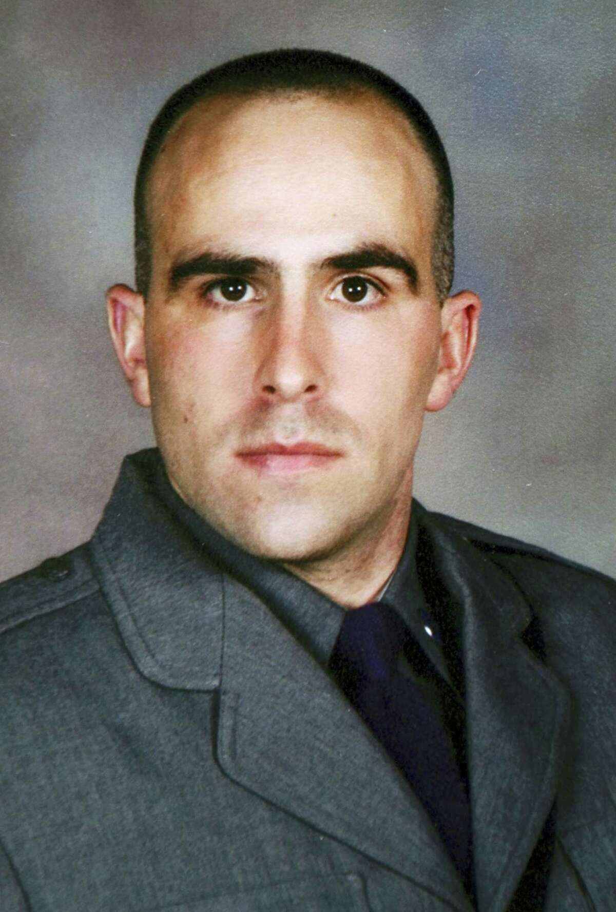 This undated photo provided by the New York State Police shows Trooper Joel Davis, who was fatally shot responding to a domestic dispute in Theresa, N.Y., on Sunday, July 9, 2017. Justin Walters, a U.S. Army soldier, was charged Monday, July 10 with murder in the shooting. (New York State Police via AP)