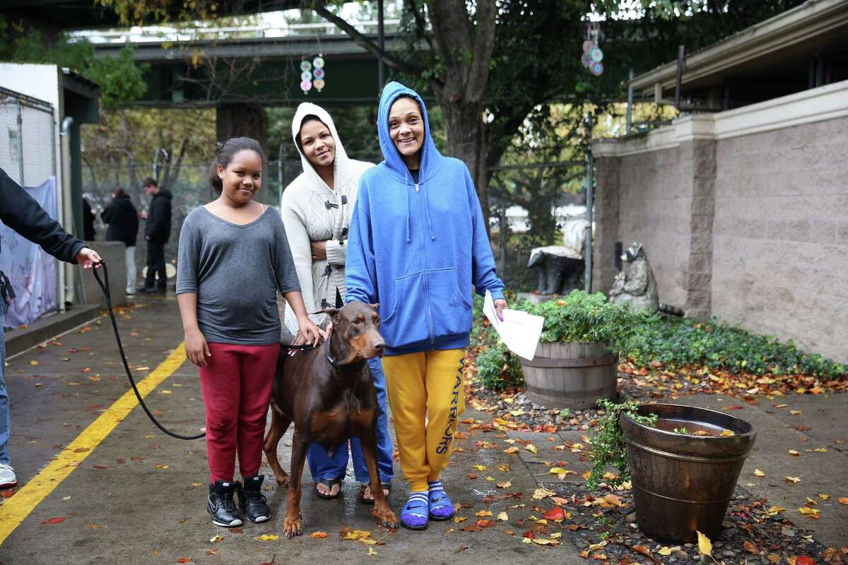 New dog owners with a pet they adopted at Sacramento's Front Street Animal Shelter. (Photo courtesy of Front Street Animal Shelter)