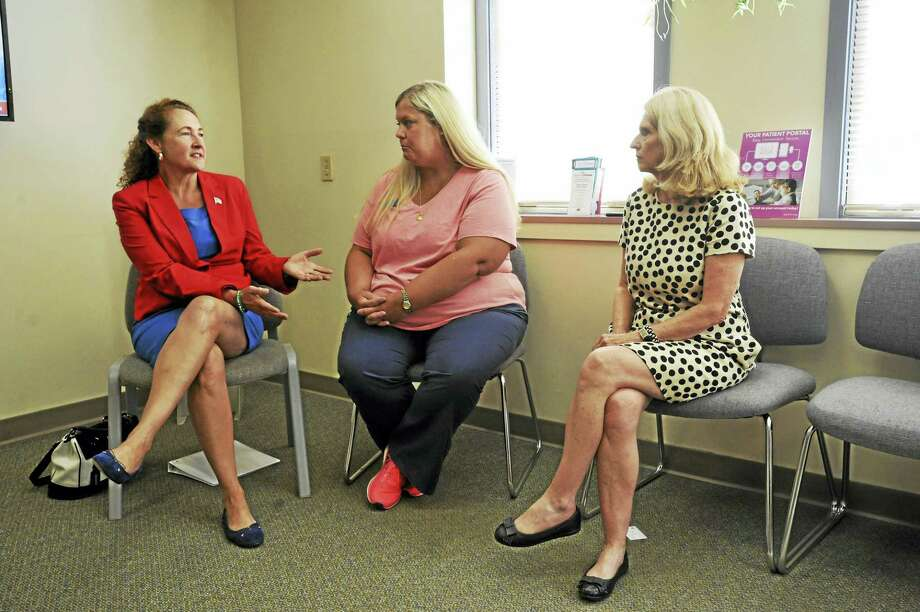 U.S. Rep. Elizabeth Esty visited the Planned Parenthood clinic in Torrington Monday to discuss the potential effects of Republican healthcare proposals now under consideration in Congress. Far right, Susan Yolen, vice president of policy and advocacy of Planned Parenthood of Southern New England; and Tammy Hreha, clinic manager, talk with Esty during her visit. Photo: Ben Lambert / Hearst Connecticut Media