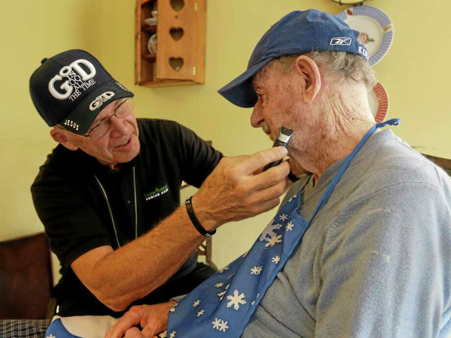 Caregiver Warren Manchess, 74, left, shaves Paul Gregoline, in Noblesville, Ind. Gregoline is 92 years old and battling Alzheimer's and needs a hand with nearly every task the day brings. Burgeoning demand for senior services like home health aides is being met by a surprising segment of the workforce: Other seniors. Twenty-nine percent of so-called direct-care workers are projected to be 55 or older by 2018 and in some segments of that population older workers are the single largest age demographic. With high rates of turnover, home care agencies have shown a willingness to hire older people new to the field who have found a tough job market as they try to supplement their retirement income. Photo: AP Photo — Darron Cummings/file  / AP
