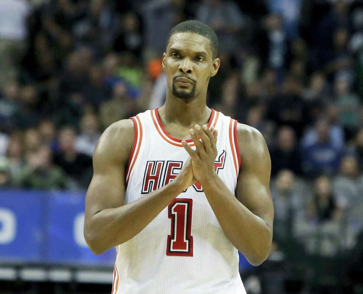 In this Feb. 3, 2016 photo, Miami Heat forward Chris Bosh reacts to a call during the second half of an NBA basketball game against the Dallas Mavericks, in Dallas. Bosh has written an open letter to Miami, thanking the city for supporting him for the past seven years. Bosh published the letter on July 9, 2017, without any mention of his current health status or any plans for his basketball future. He was waived by the Heat last week, and hasn't been able to play in an NBA game since February 2016.