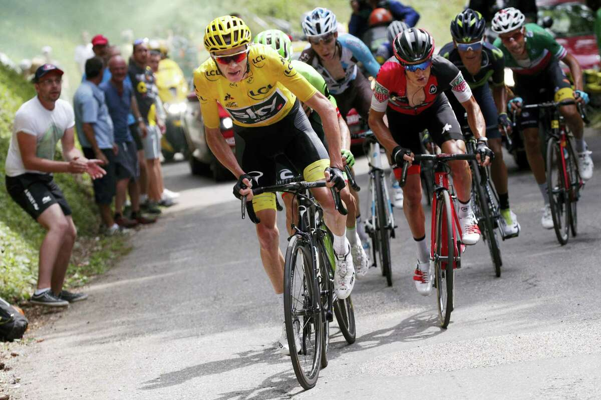 Britain's Chris Froome, wearing the overall leader's yellow jersey, Australia's Richie Porte, in red and black, Colombia's Nairo Quintana, second right, and Italy's Fabio Aru, far right, climb towards Mont du Chat pass during the ninth stage of the Tour de France cycling race over 181.5 kilometers (112.8 miles) with start in Nantua and finish in Chambery, France on July 9, 2017.