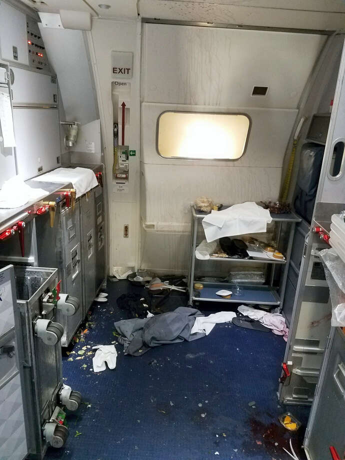 This Friday, July 7, 2017 photo taken the FBI and released via the U.S. Attorney's Office in Seattle shows the aftermath of a cabin on Delta Flight 129 from Seattle to Beijing, after authorities say flight attendants struggled with Joseph Daniel Hudek IV, a passenger who lunged for an exit door. The photo was included in a criminal complaint filed Friday, July 7. The passenger is charged with interfering with a flight crew and faces up to 20 years in prison. Photo: FBI Via U.S. Attorney's Office In Seattle Via AP  / Federal Bureau of Investigation