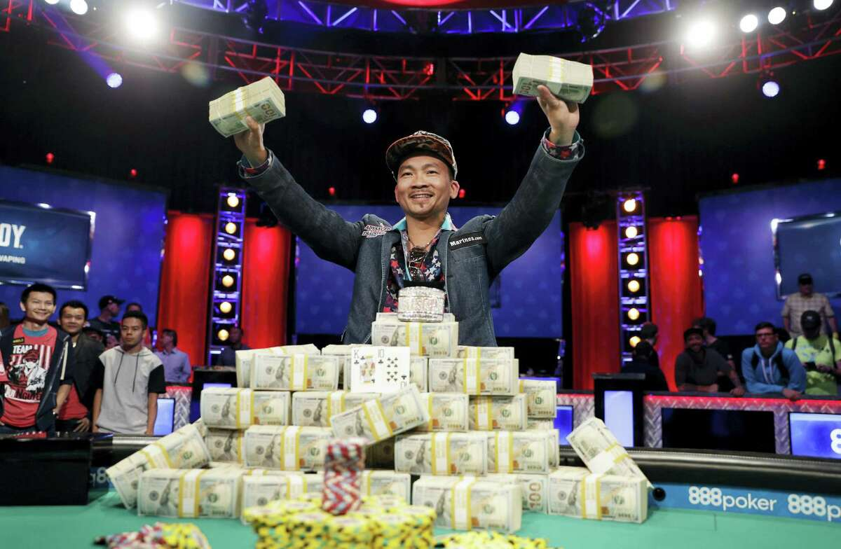 Qui Nguyen poses for photographers after winning the 2016 World Series of Poker Main Event in Las Vegas.