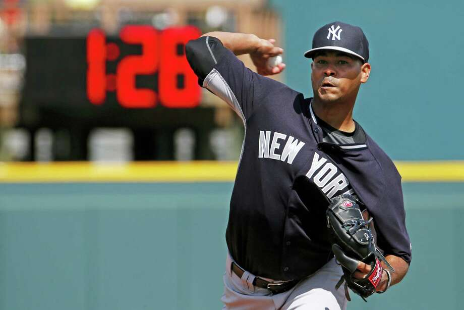 Yankees pitcher Esmil Rogers (53) warms up between innings of a spring training game with a pitch clock in the background. Photo: The Associated Press File Photo  / Copyright 2017 The Associated Press. All rights reserved.