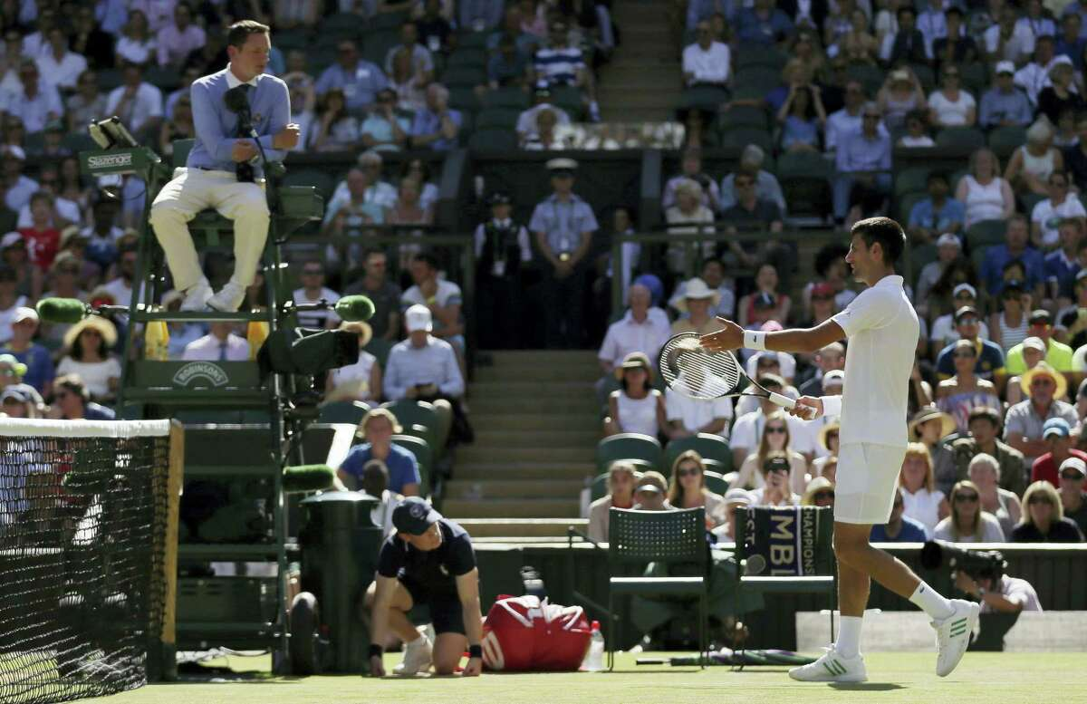 Novak Djokovic gestures to umpire Jake Garner as he disputes a call in his men's singles match with Ernests Gulbis on Saturday.