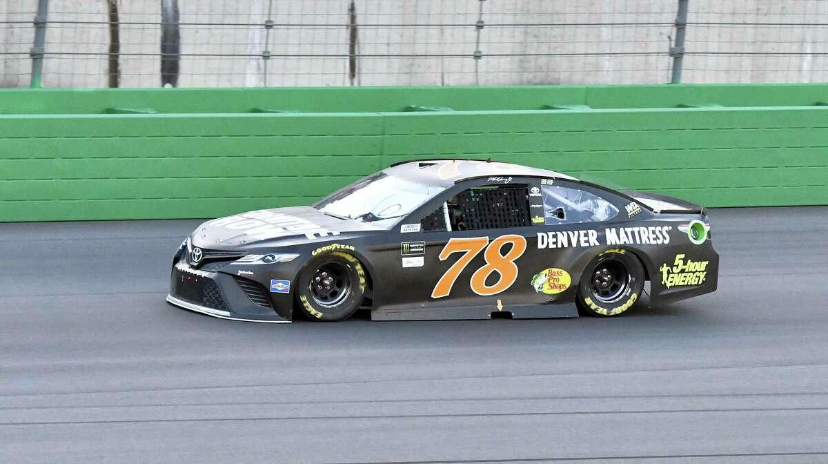 Martin Truex Jr. (78) heads into Turn 1 at Kentucky Speedway.