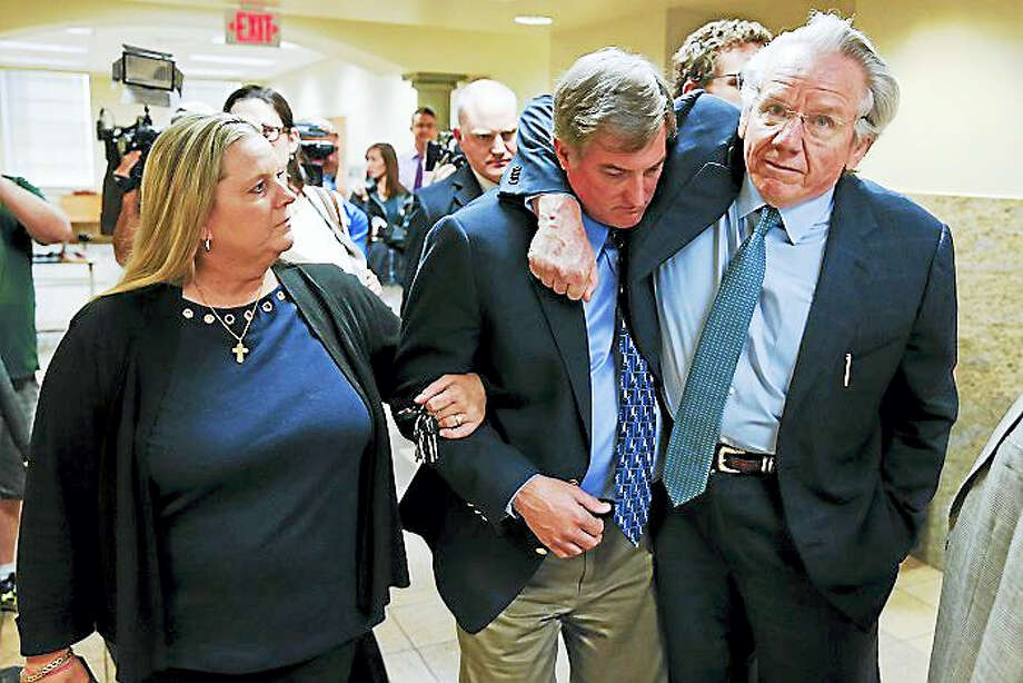 Shannon Kepler walks with his wife, Gina, while his attorney, Richard O'Carroll, puts his arm around him after a hung jury verdict was announced at the Tulsa Country Courthouse, Friday, July 7, 2017, in Tulsa, Okla. A third mistrial was declared Friday in the murder case of Kepler, a white former Oklahoma police officer accused in the off-duty fatal shooting of his daughter's black boyfriend. Photo: Ian Maule/Tulsa World Via AP   / Tulsa World