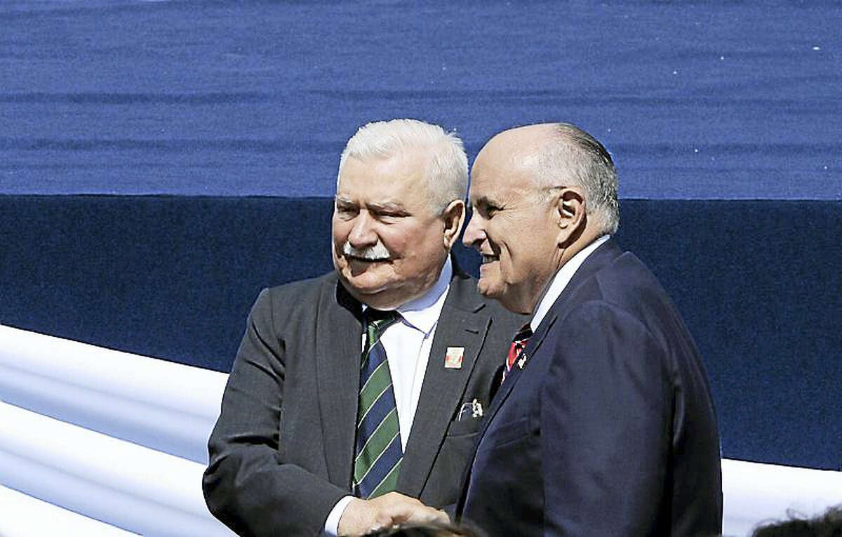 Former New York Mayor Rudolph Giuliani, right, poses for a photograph with Poland's former president and legendary Solidarity freedom movement founder Lech Walesa, prior to U.S. President Donald Trump's speech in Krasinski Square, in Warsaw, Poland, Thursday, July 6, 2017.