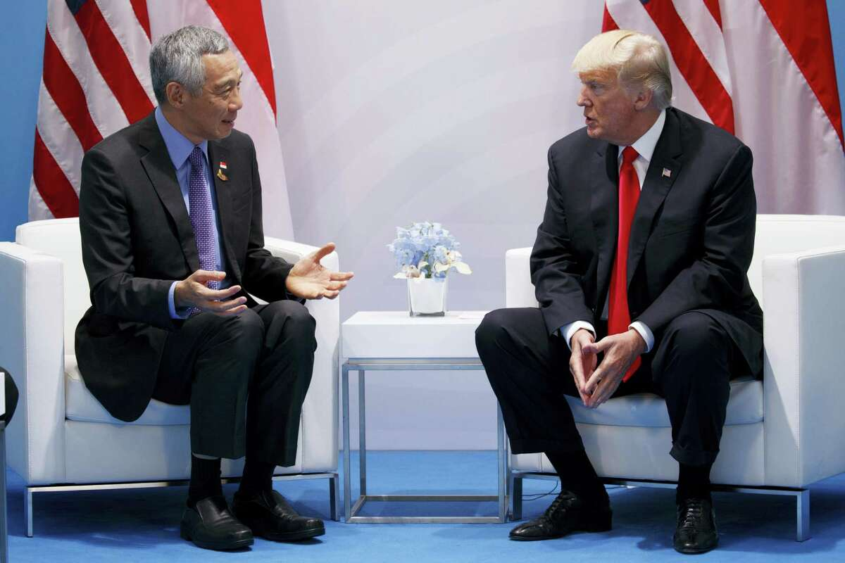 President Donald Trump meets with Singapore's Prime Minister Lee Hsien Loong at the G20 Summit, Saturday, July 8, 2017, in Hamburg, Germany.