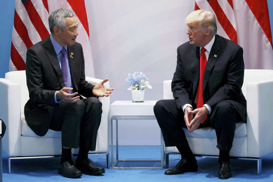 President Donald Trump meets with Singapore's Prime Minister Lee Hsien Loong at the G20 Summit, Saturday, July 8, 2017, in Hamburg, Germany. Photo: AP Photo/Evan Vucci   / Copyright 2017 The Associated Press. All rights reserved.