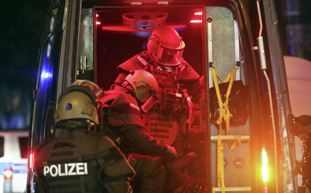 Heavily armed special police forces arrive at the so-called 'Schanzenviertel' area after riots started on the sidelines of the G-20 summit in Hamburg, northern Germany, Friday evening, July 7, 2017.