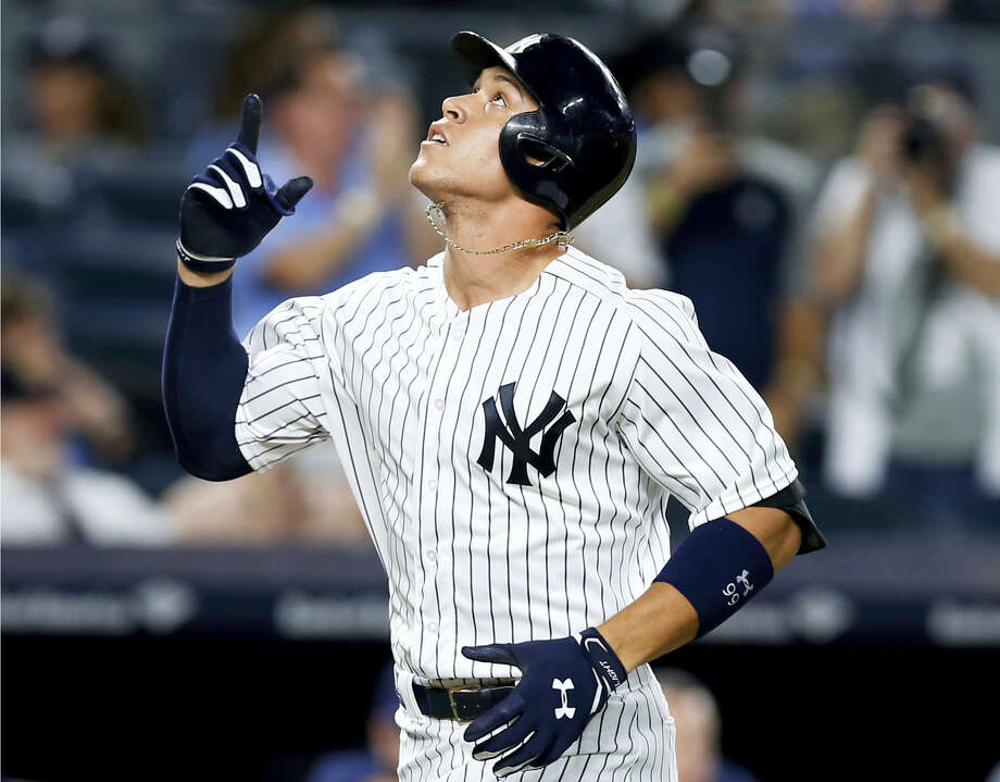 The Yankees' Aaron Judge points skyward after hitting a fifth-inning solo home run against the Brewers on Friday in New York. Photo: Kathy Willens — The Associated Press  / Copyright 2017 The Associated Press. All rights reserved.