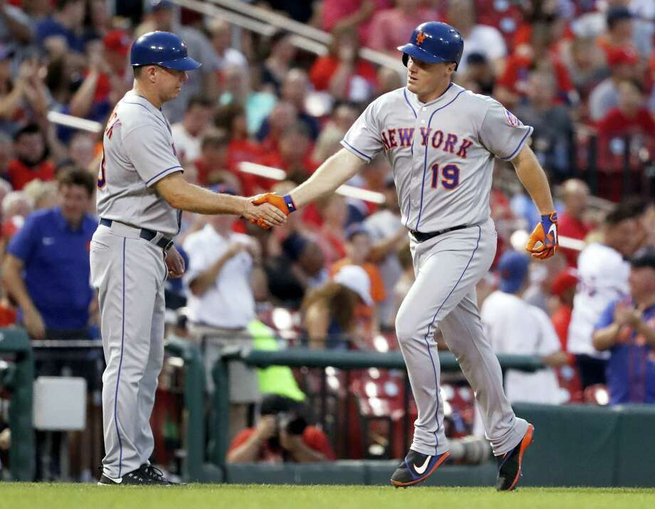 The Mets' Jay Bruce, right, is congratulated after hitting a solo home run in the fifth inning Friday. Photo: Jeff Roberson — The Associated Press  / Copyright 2017 The Associated Press. All rights reserved.