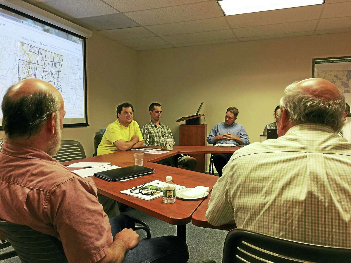 Tim Abbott and Ryan Williams of the Housatonic Valley Association presented a map of the trails that crisscross the region to local chief elected officials Thursday in Goshen.