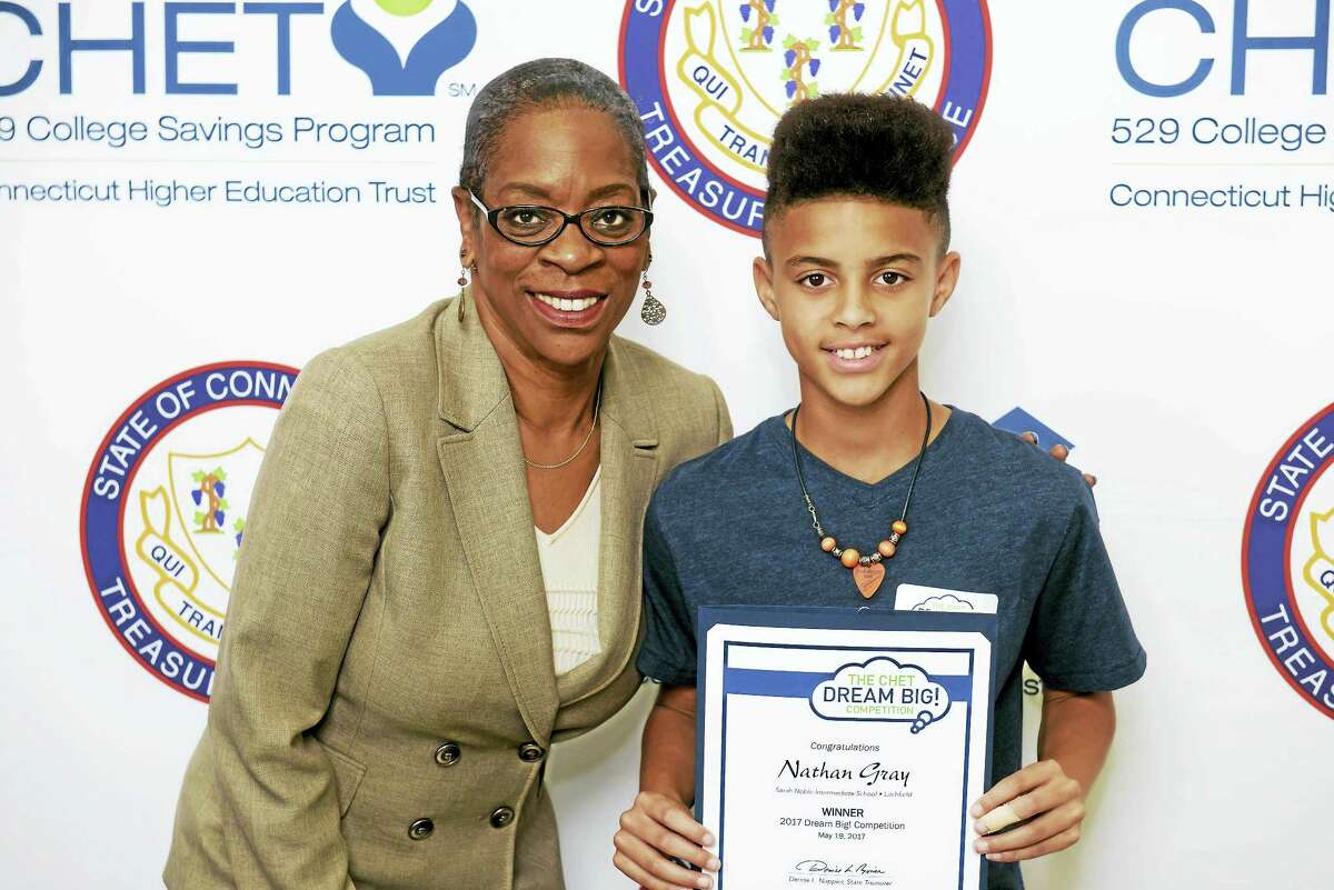 Nathan Gray of New Milford poses with State Treasurer Denise Nappier after winning the CHET competition.
