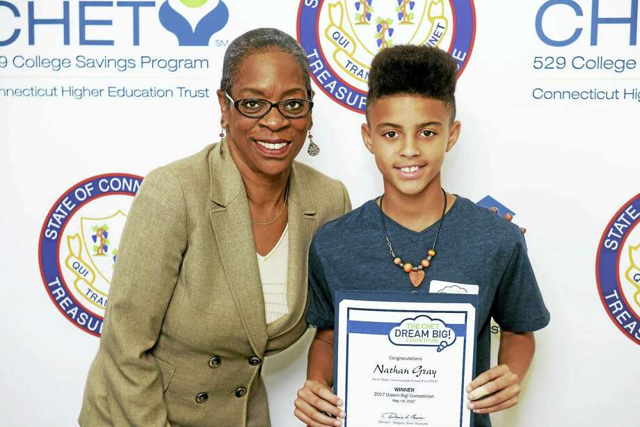 Nathan Gray of New Milford poses with State Treasurer Denise Nappier after winning the CHET competition. Photo: Contributed Photos