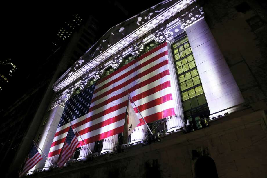 An American flag hangs on the front of the New York Stock Exchange. Photo: Peter Morgan / The Associated Press File  / Copyright 2017 The Associated Press. All rights reserved.