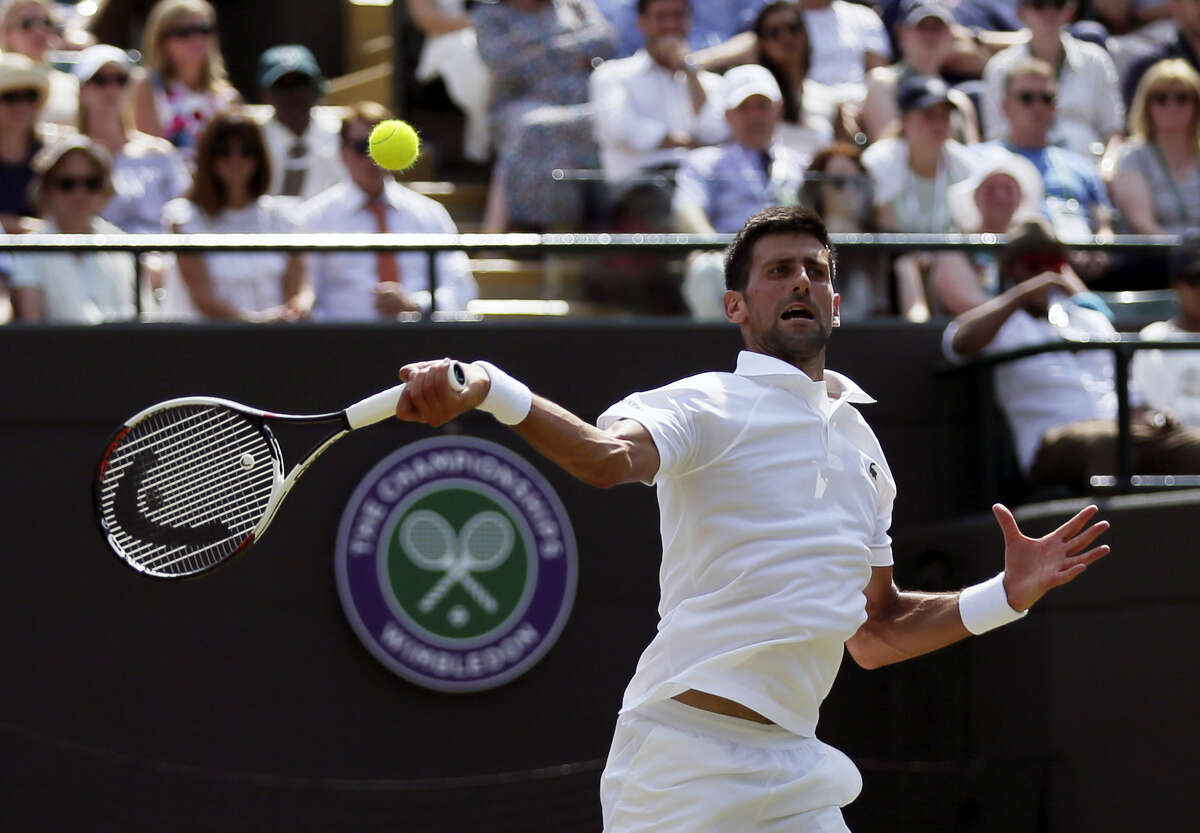 Novak Djokovic plays against Adam Pavlasek during their men's singles match Thursday at Wimbledon.
