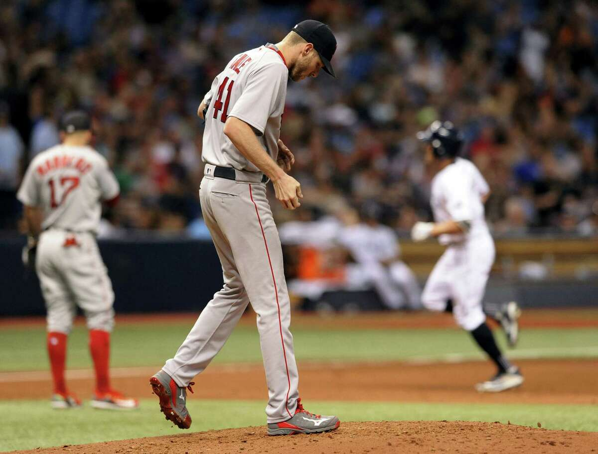 Red Sox starter Chris Sale walks around the mound as the Rays' Peter Bourjos circles the bases after hitting a solo home run in the fifth inning Thursday in St. Petersburg, Fla.