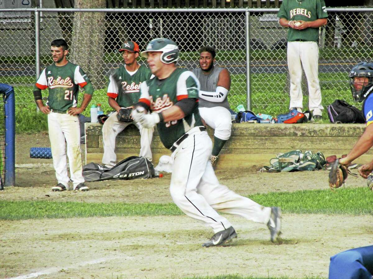 Photo by Peter Wallace Player/coach Greg Bodnar broke open a marathon Torrington Tri-State League win over Winsted with a two-run single in the top of the 10th Thursday evening at Walker Field.