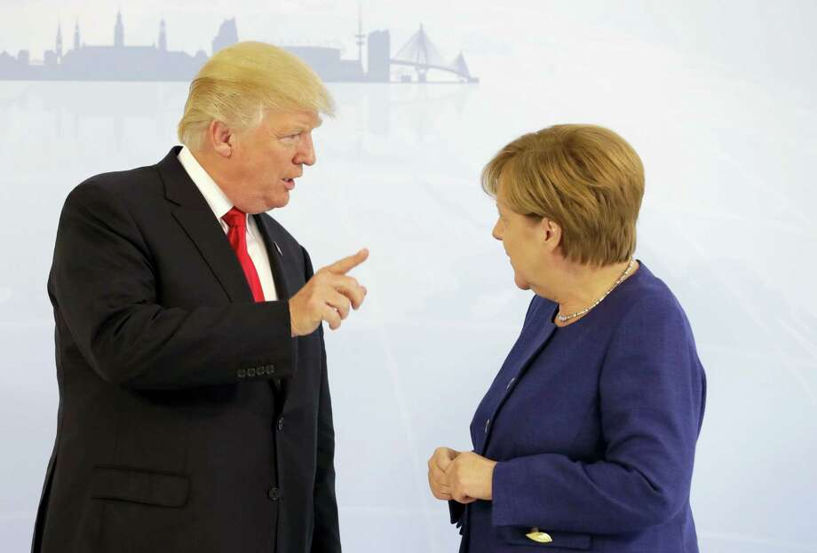 U.S. President Donald Trump, left, and German Chancellor Angela Merkel pose for a photograph prior to a bilateral meeting on the eve of the G-20 summit in Hamburg, northern Germany, Thursday, July 6, 2017. The leaders of the group of 20 meet July 7 and 8. Photo: Matthias Schrader / AP Photo, Pool  / Copyright 2017 The Associated Press. All rights reserved.