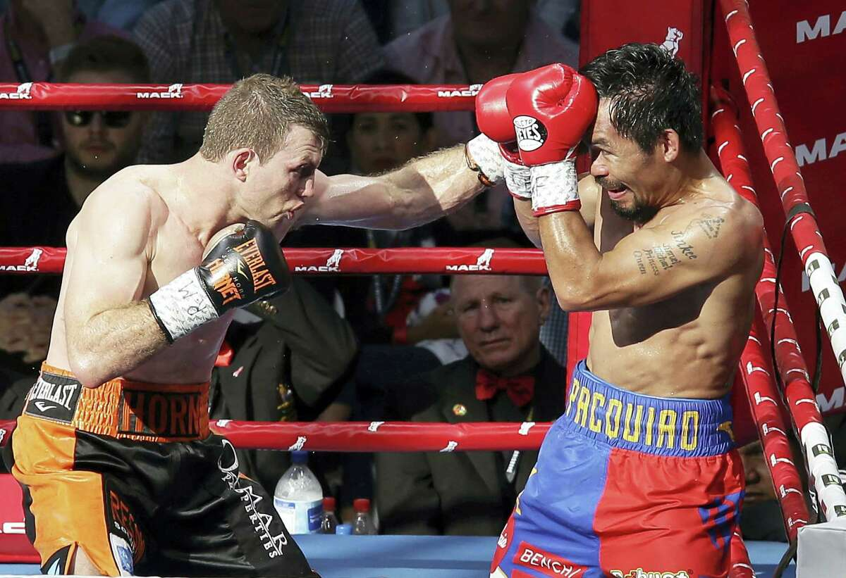 Jeff Horn of Australia, left, lands a left to Manny Pacquiao of the Philippines during their WBO World Welterweight title fight in Brisbane, Australia on July 2, 2017.