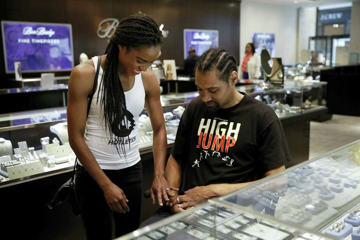 Two-time Olympic high jumper Jamie Nieto, right, and his fiancee Shevon Stoddart, a Jamaican hurdler, smile as they look at their wedding rings at a jewelry store ahead of their July wedding on June 8, 2017 in Torrance, Calif. Nieto proposed to the Jamaican hurdler while in a wheelchair as he recovered from a spinal cord injury after a mistimed backflip. Up to 130 steps with no assistance, he fully intends to walk her down the aisle at their wedding on July 22.