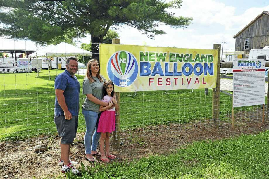 Matthew Soulier and Alicia DaPonte, seen here with her daughter, Ava, are preparing to hold the New England Balloon Festival on the Goshen Fairgrounds. Photo: Ben Lambert / HEARST CONNECTICUT MEDIA