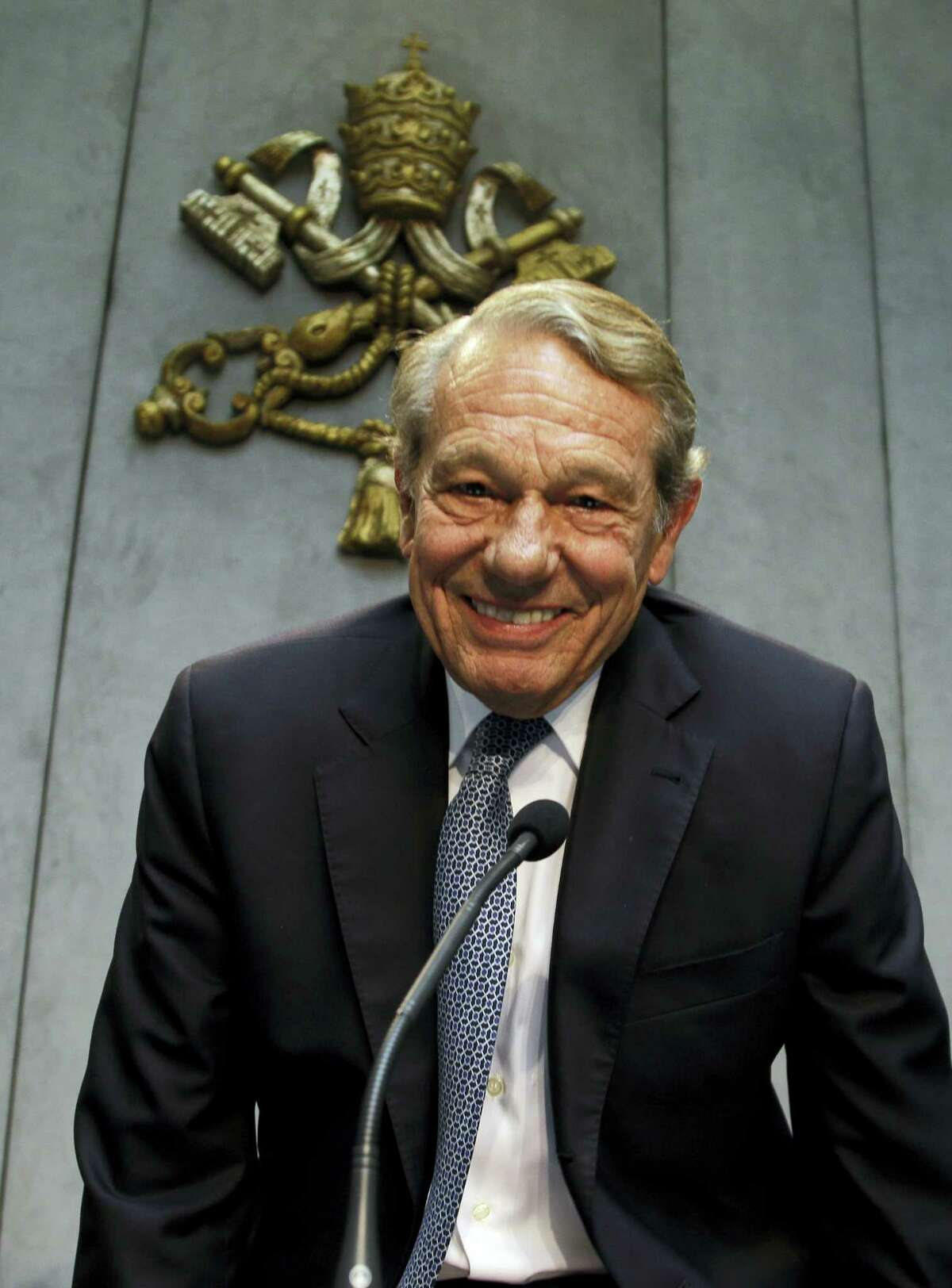 In this photo taken on April 25, 2014, former Pope John Paul II spokesperson Joaquin Navarro-Valls smiles prior to the start of a press conference at the Vatican. Joaquin Navarro-Valls, a suave, silver-haired Spaniard who was a close confidant of Pope John Paul II, serving for more than two decades as chief Vatican spokesman, has died at the age of 80, Wednesday, July 5, 2017.