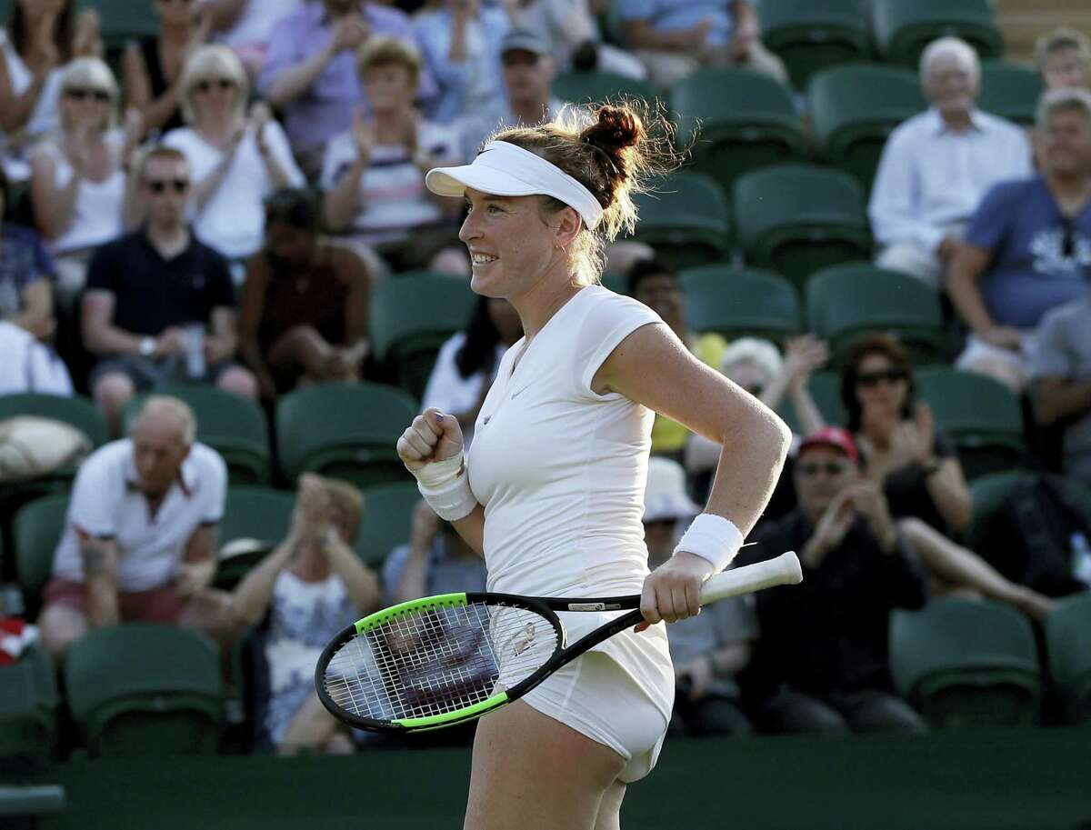 Madison Brengle of the United States celebrates after winning against Czech Republic's Petra Kvitova in their singles match on day three at the Wimbledon Tennis Championships in London.