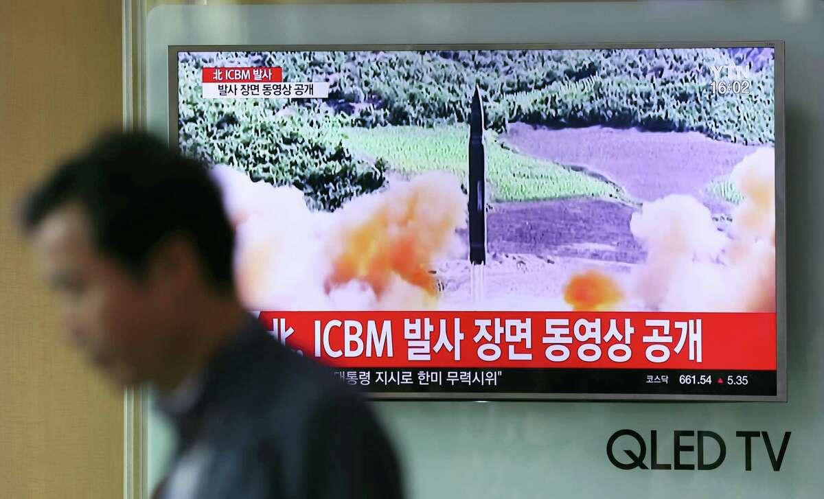 A man walks by a TV screen showing a local news program reporting about North Korea's missile firing at Seoul Train Station in Seoul, South Korea, Wednesday, July 5, 2017. North Korea's newly demonstrated missile muscle puts Alaska within range of potential attack and stresses the Pentagon's missile defenses like never before. Even more worrisome, it may be only a matter of time before North Korea mates an even longer-range ICBM with a nuclear warhead, putting all of the U.S. at risk.