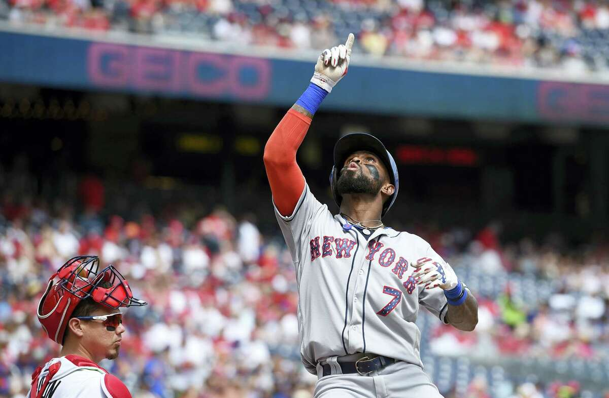 New York Mets' Jose Reyes celebrates as he crosses home plate after hitting a home run in the first inning.