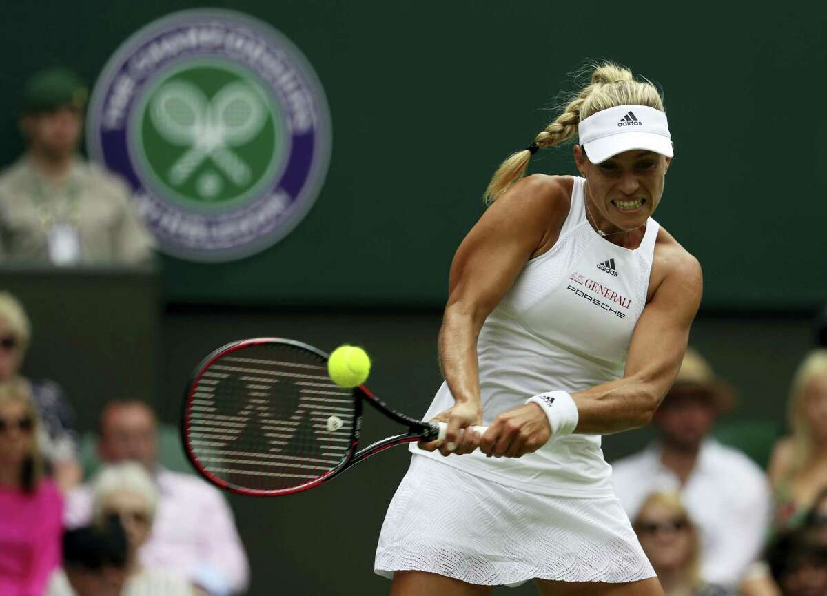 Angelique Kerber returns to Irina Falconi during their singles match on day two at the Wimbledon Tennis Championships in London Tuesday.