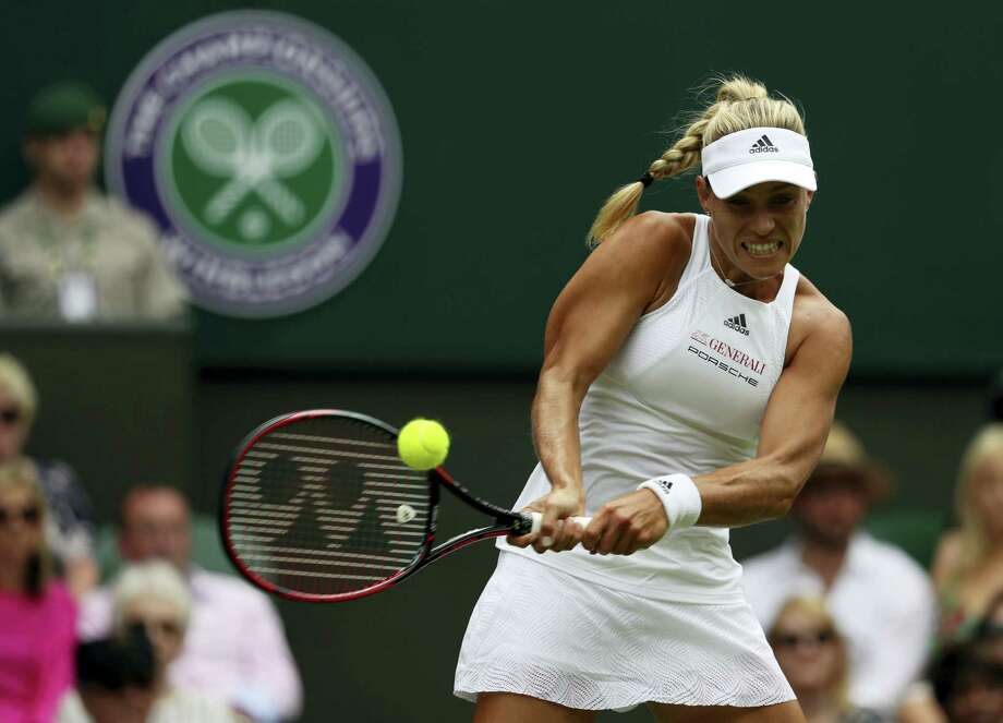 Angelique Kerber returns to Irina Falconi during their singles match on day two at the Wimbledon Tennis Championships in London Tuesday. Photo: ALASTAIR GRANT - THE ASSOCIATED PRESS  / Copyright 2017 The Associated Press. All rights reserved.