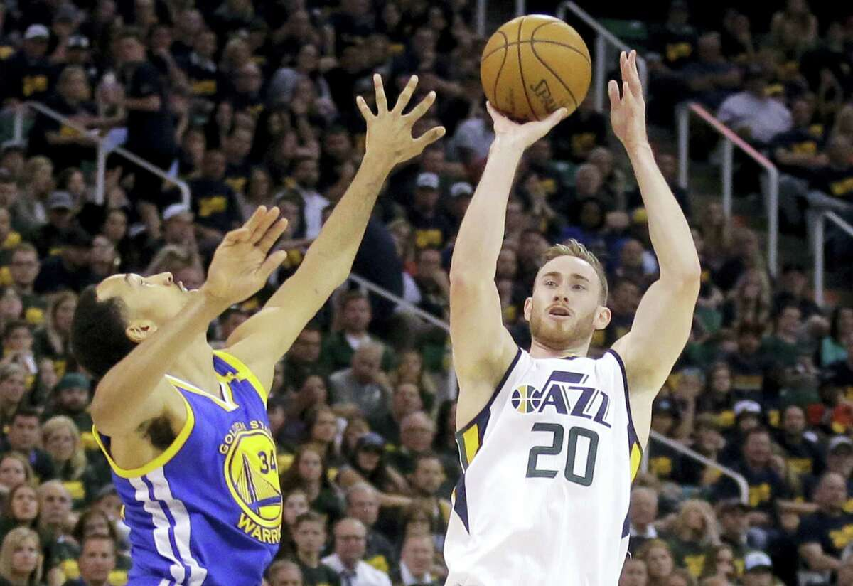 In this May 6 file photo, Utah Jazz forward Gordon Hayward (20) shoots during Game 3 of the NBA basketball second-round playoff series against the Golden State Warriors. Hayward has chosen to sign with the Boston Celtics and reunite with former college coach Brad Stevens, making the announcement Tuesday evening on The Players' Tribune site.