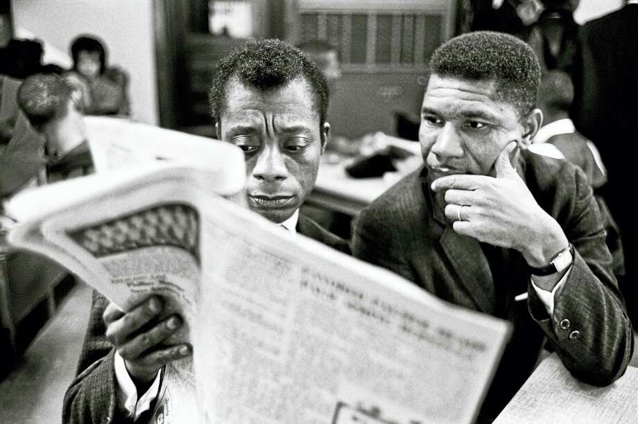 James Baldwin (left) in 1963 in Mississippi, where he visited the NAACP's Medgar Evers. Photo: Courtesy Of Steve Schapiro Via The Washington Post   / Steve Schapiro