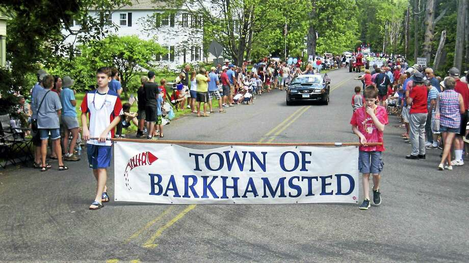 Participants proudly display the town banner during the annual Barkhamsted Fourth of July parade. Photo: Photo/John Torsiello