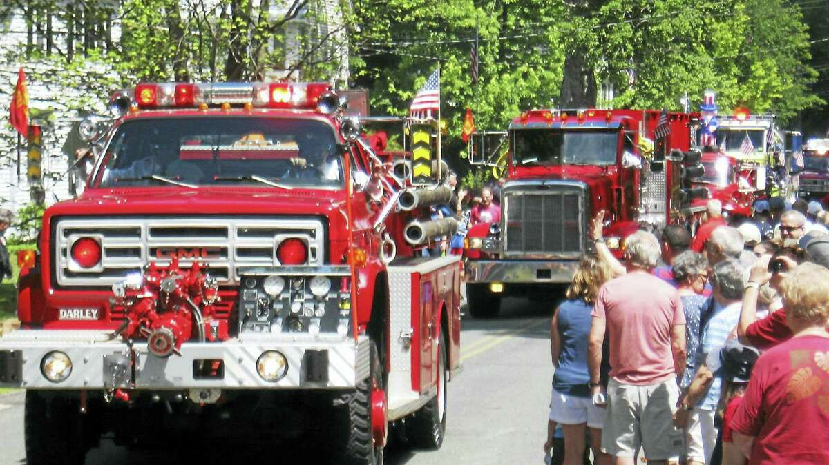 Fire trucks move down the parade route.