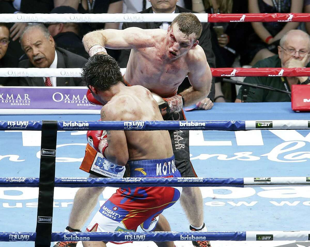 Jeff Horn, top, of Australia and Manny Pacquiao of the Philippines fight during their WBO World welterweight title bout in Brisbane, Australia on July 2, 2017. Pacquiao lost his WBO welterweight world title to Horn in a stunning, unanimous points decision in the Sunday afternoon bout billed as the Battle of Brisbane in front of more than 50,000 people.