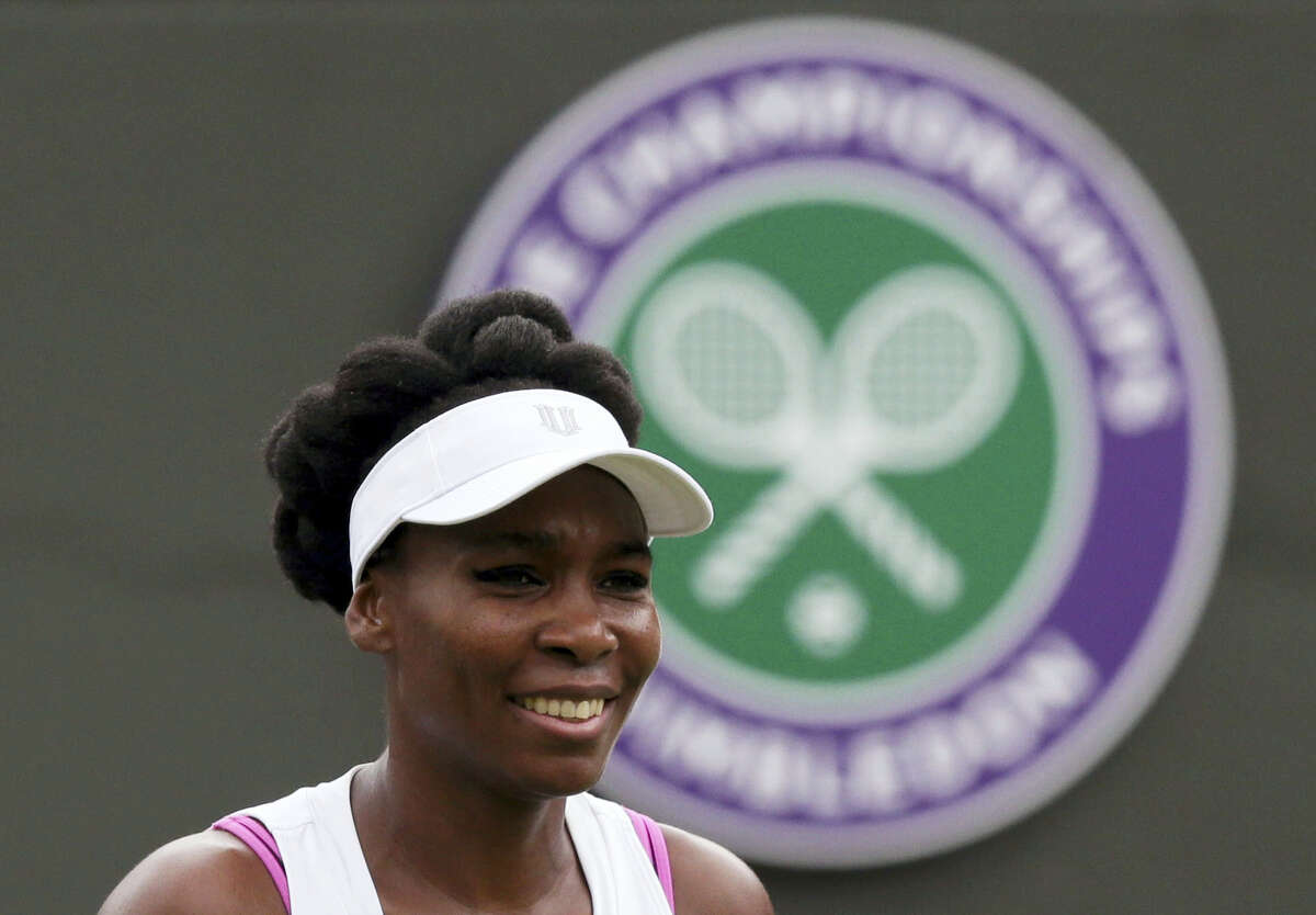 Venus Williams of the United States looks on during her Women's Singles Match against Belgium's Elise Mertens on the opening day at the Wimbledon Tennis Championships in London on Monday, July 3, 2017.