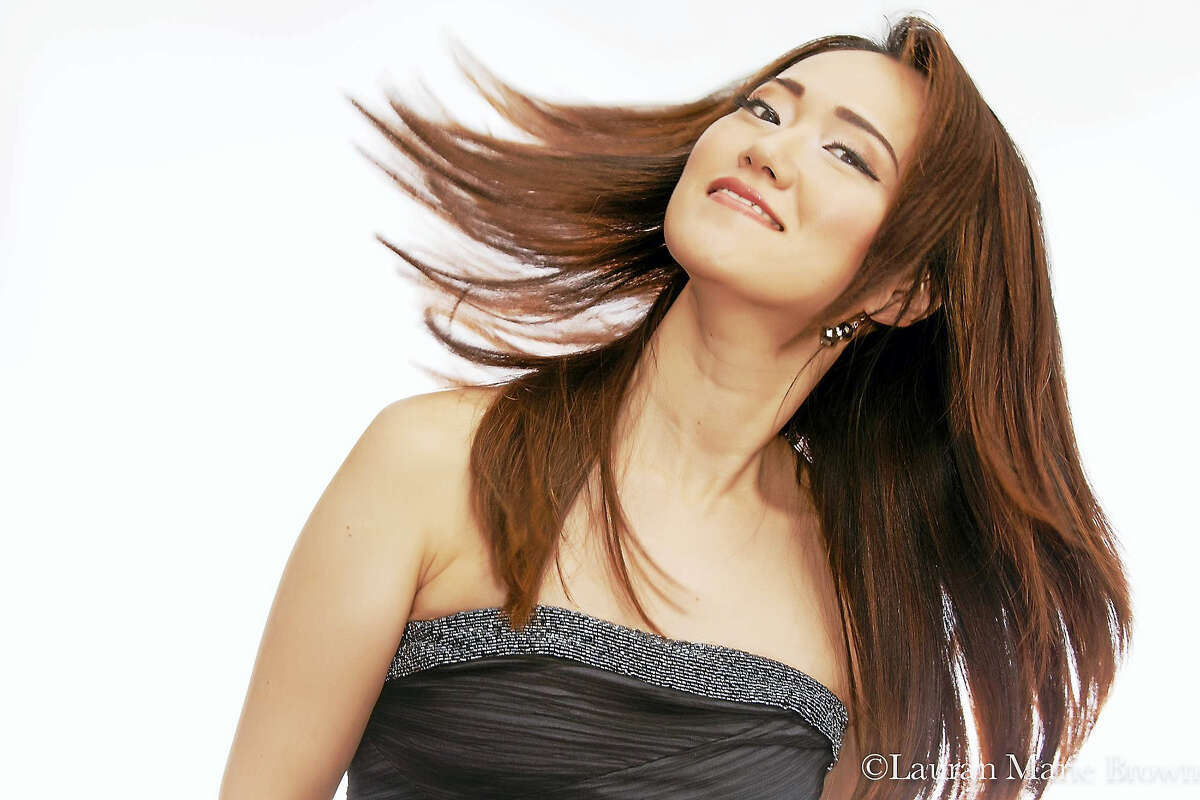The Yoko Miwa Trio performs at the Palace Theater's Poli Club on July 21.