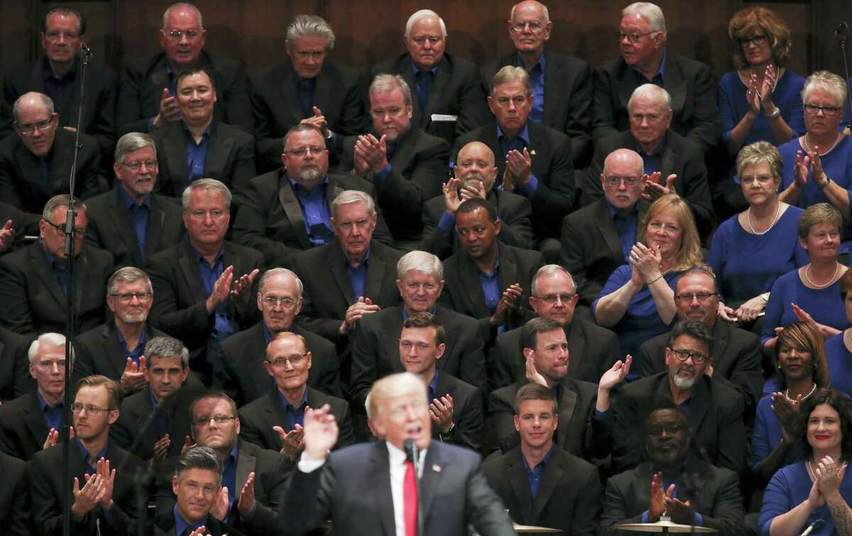 Members of the First Baptist Dallas Church Choir are seated behind President Donald Trump as he speaks during the Celebrate Freedom event at the Kennedy Center for the Performing Arts in Washington on July 1, 2017.